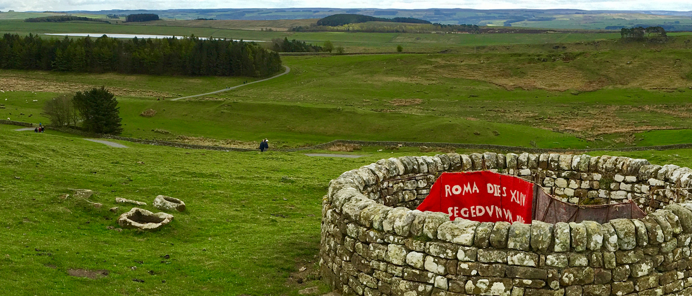 Art installation in the landscape at Housesteads evoking a cape crossed with a signpost