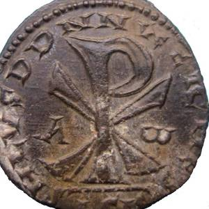 Coin with Christian chi rho symbol signifying that Christianity was now the official state religion.