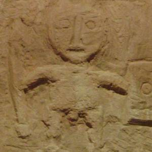 Carving of a local god