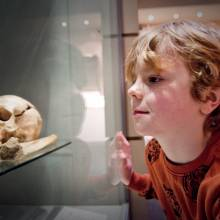 Young visitor in the Set in Stone Gallery in the museum