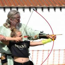 Trying archery at the Arbeia Festival 2018